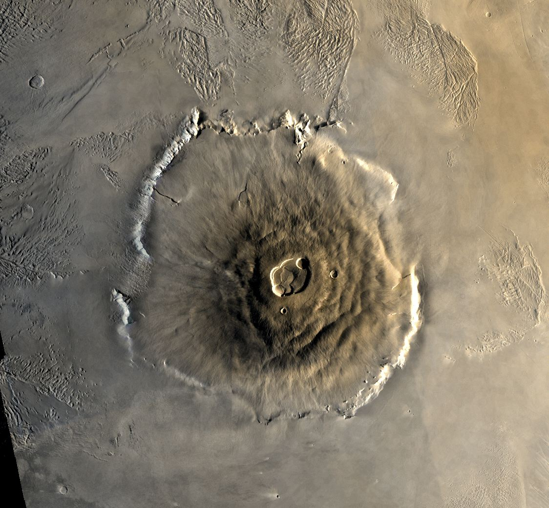 Image is a photo of Olympus Mons from space. It is huge.