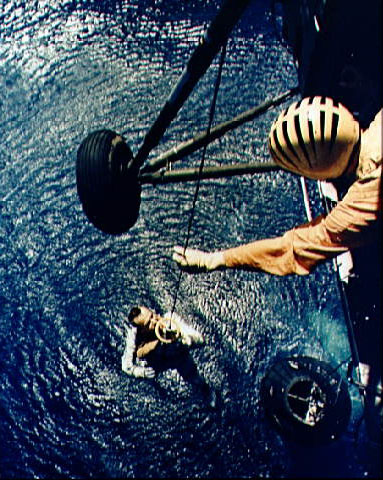 Alan Shepard being lifted from the Mercury Redstone 3 splashdown site, NASA photo mercury_shepard_rescue.jpg
