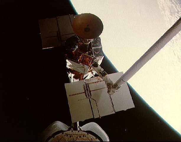 Solar Maximum Mission Observatory being captured by STS-41C (Challenger) during its repair, NASA photo smm_capture.jpg