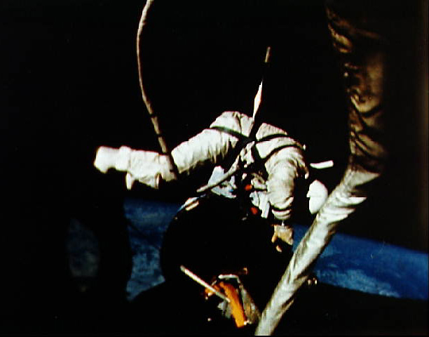 Gemini 12 astronaut Buzz Aldrin performing EVA tasks outside the capsule, NASA photo gemini_12.jpg