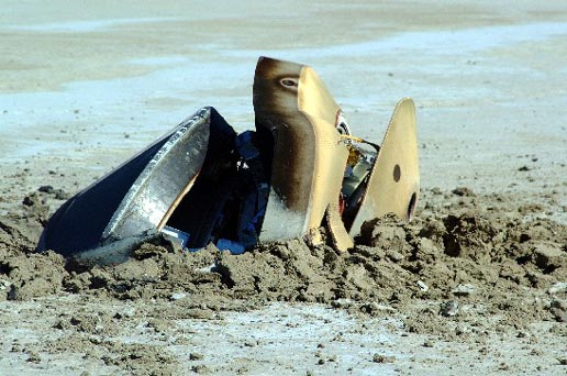Genesis sample return capsule on the ground after impact, NASA photo genesis_capsule_ground_2.jpg