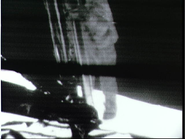 Neil Armstrong taking humanity's first step onto another planetary body, the MoonNASA photo ID S69-42583, picture taken by the Apollo Lunar surface camera a11tvarm.jpg